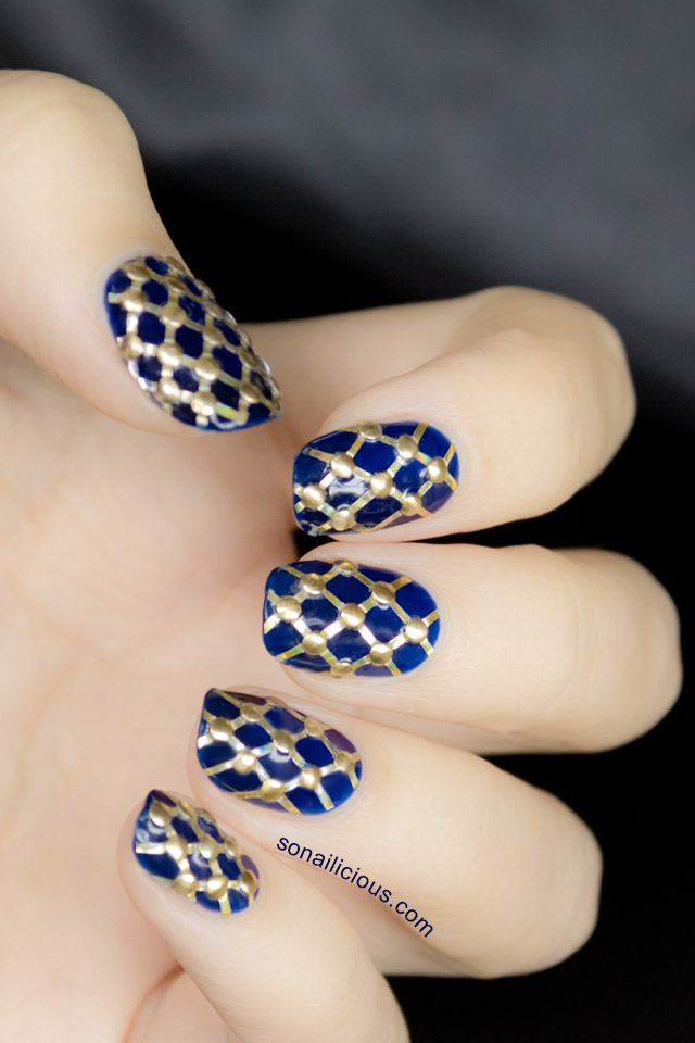 pretty studded nails blue and gold nails