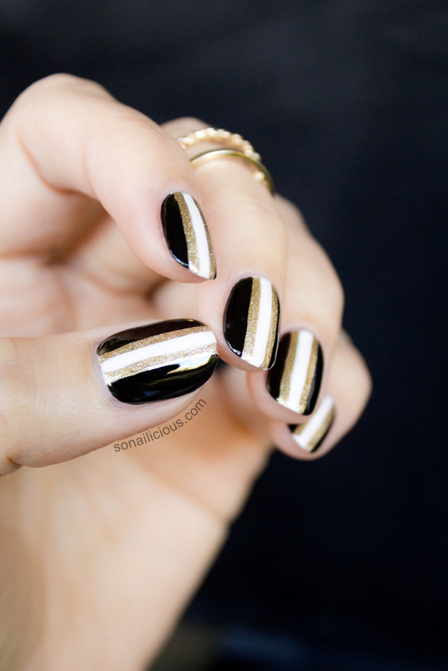 black and gold new years nails 1
