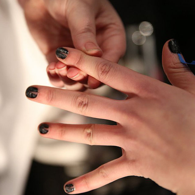 Spikey negative space moon manicure at Emerson