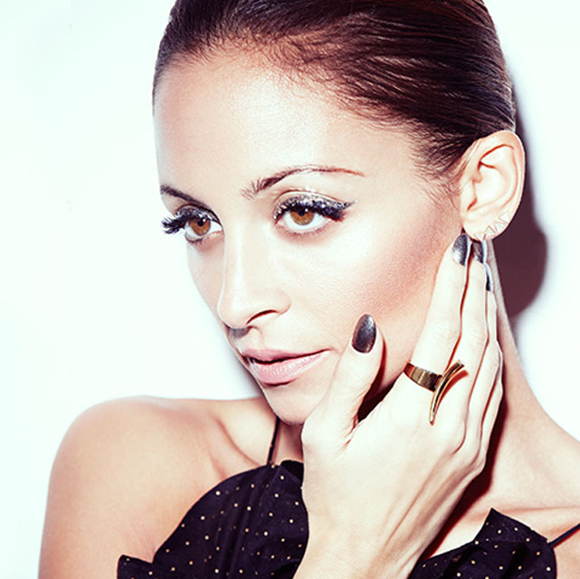 Nicole Richie, gunmetal nails and statement ring
