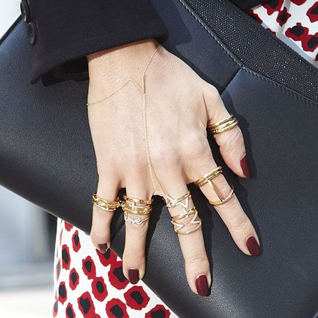 Short dark red nails and gold rings, SaksFifthAvenue