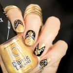 Armoured Black and Gold Nails