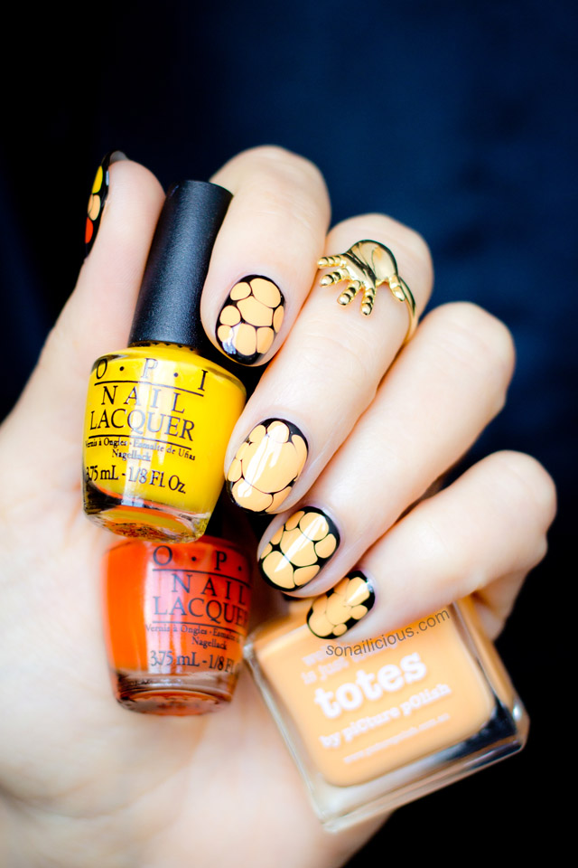 orange and black Halloween nail art