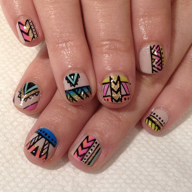 Tribal Freestyle nail art by @superflynails