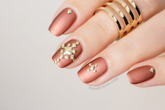 Bronze studded nails by @So_Nailicious