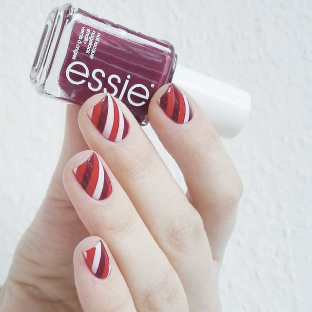 Stripey Valentine's nails by @lenareitz