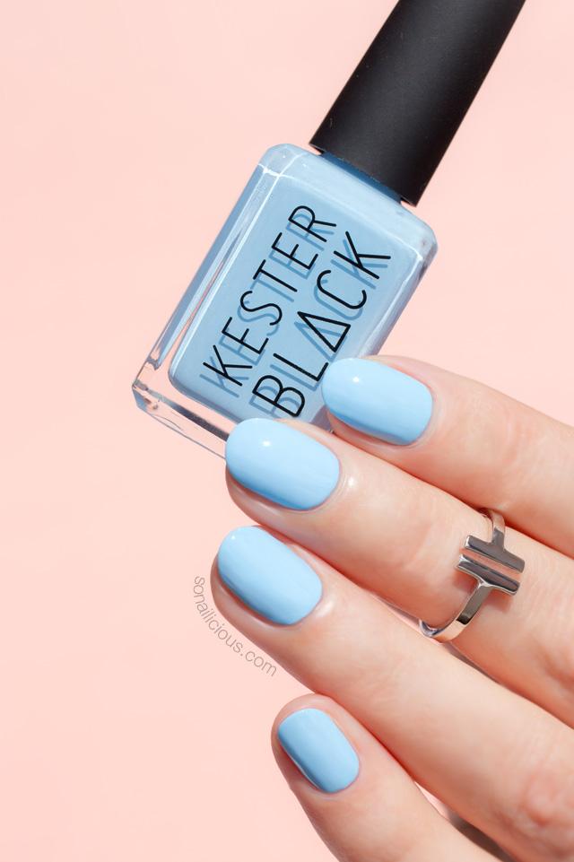 kester black cumulus, light blue nails