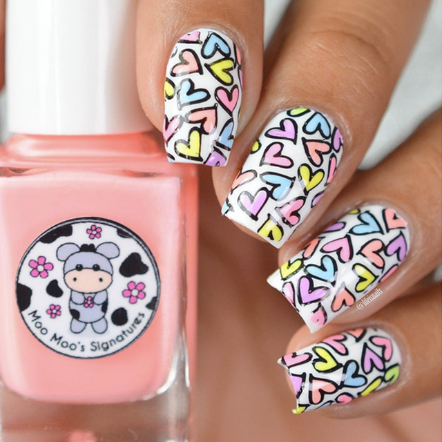 Pastel love heart nails by @lifeisnails