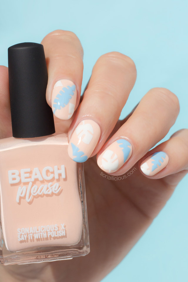 peach nails with palm leaf print