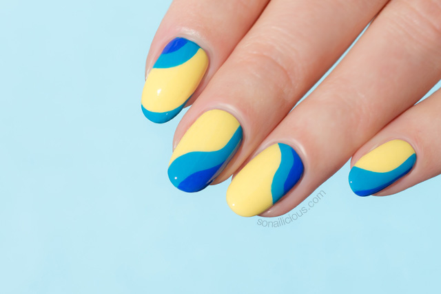 Yellow Nails With Ocean Waves Plus Lancome Nail Polish