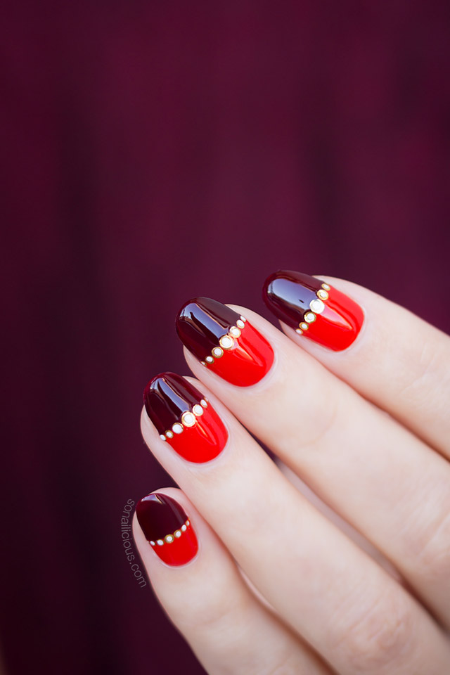 gold and red nail design