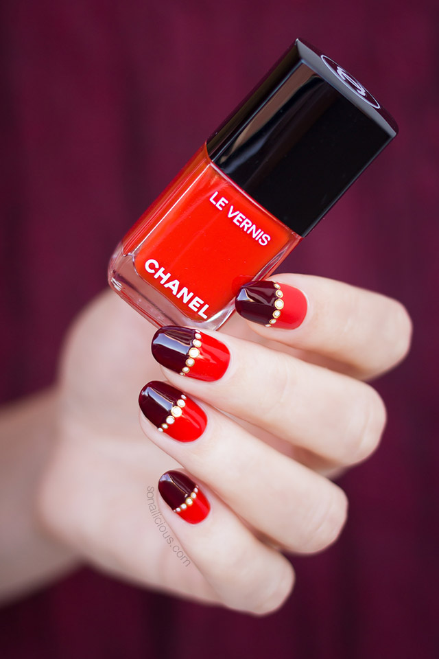 nail design with red chanel nail polish