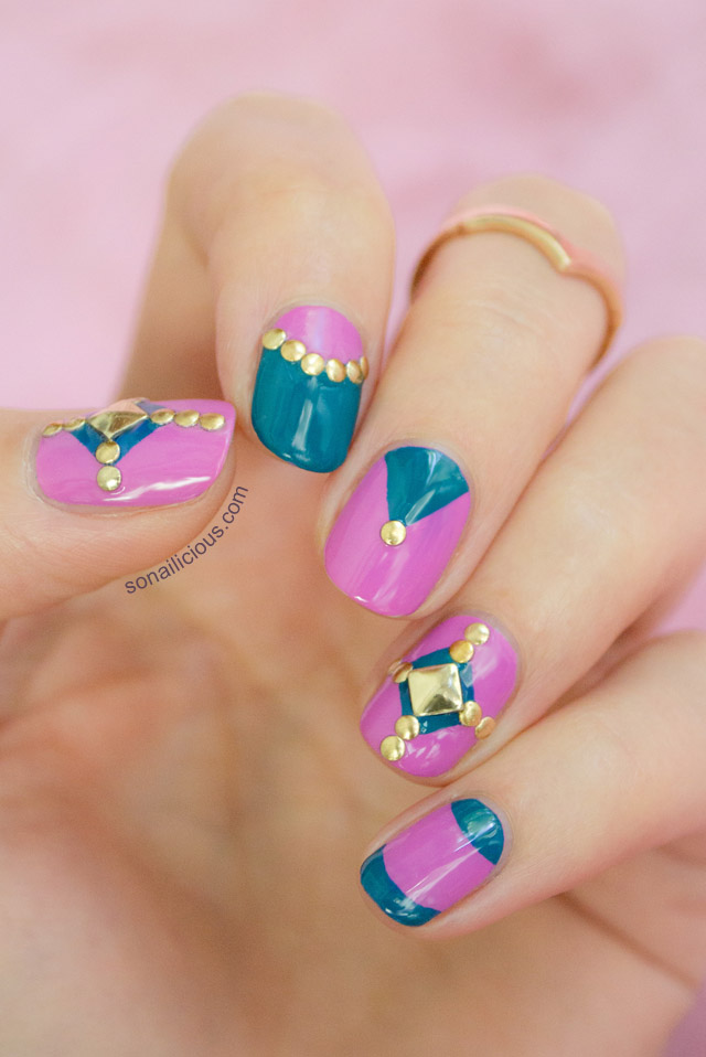 pink nail design with studs