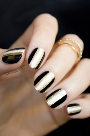 black and gold new years nails