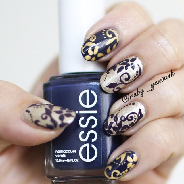 Blue and gold brokade nail art by @ruby_yenoanh