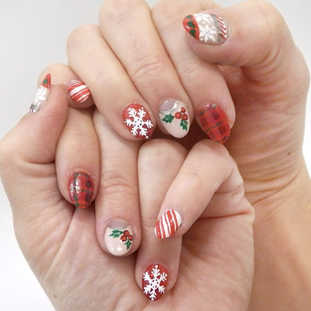 Christmas traditions nails by @pretty_squared