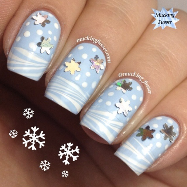 Snowy water marble tips nails with glitter snowflakes by @mucking_fusser