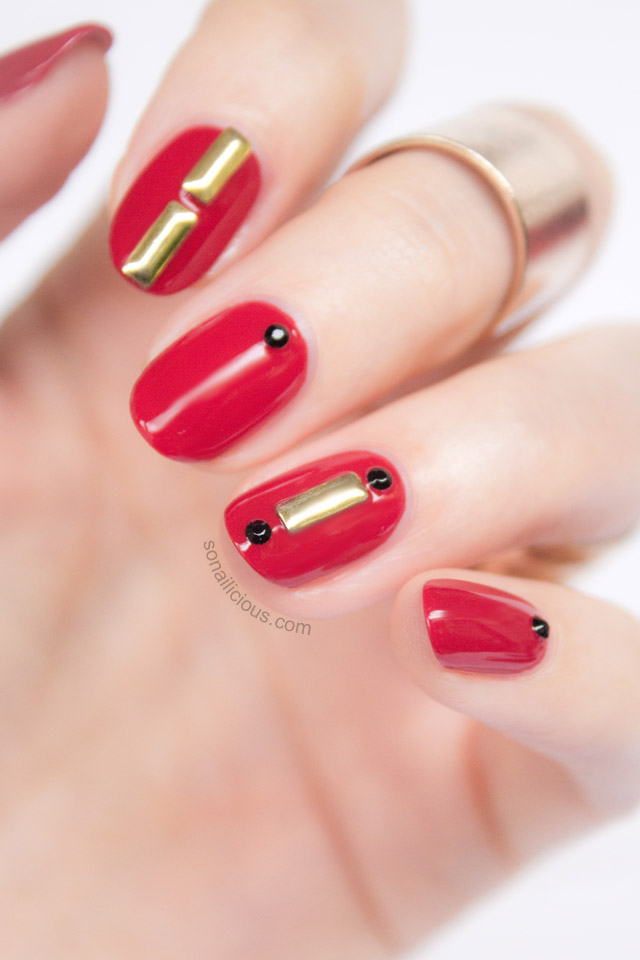 red nails with studs