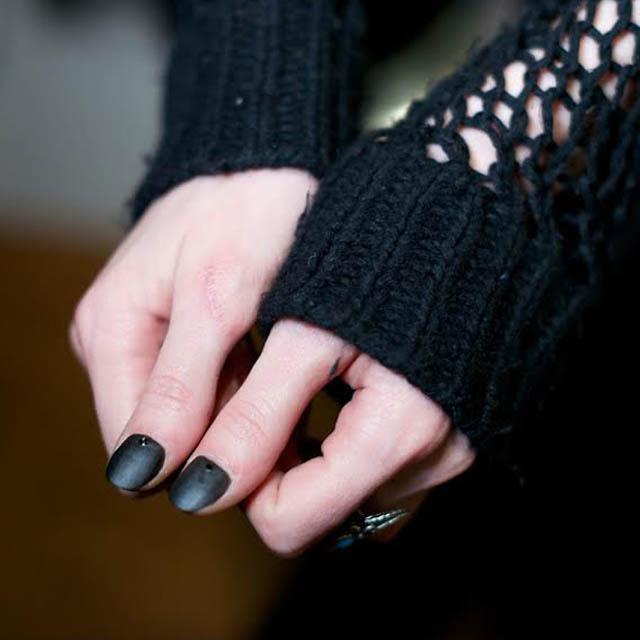 Black matte thumb nails with tiny moons at Assembly