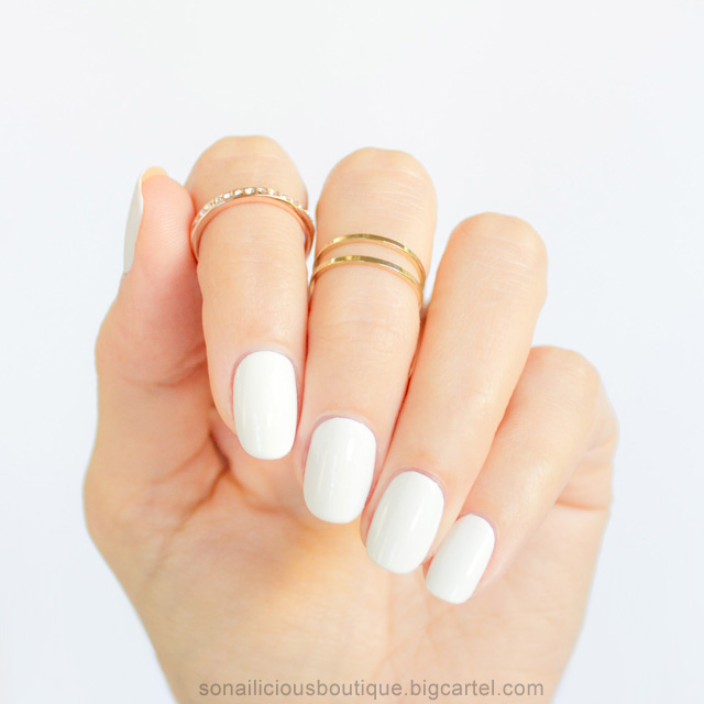 White nails and dainty gold rings