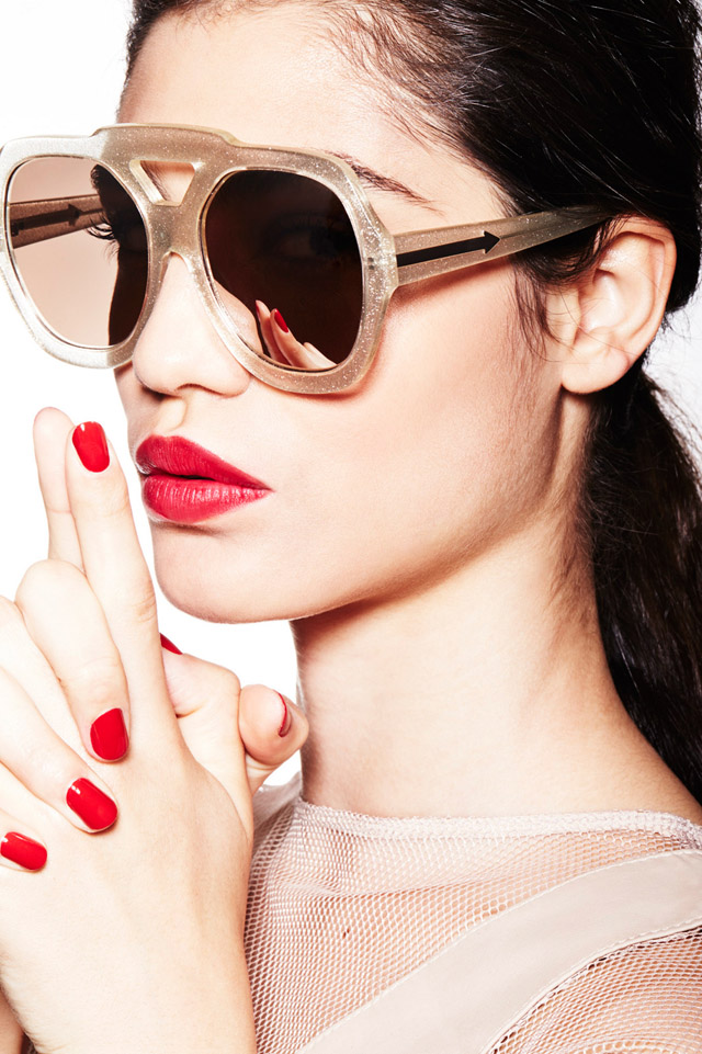 gold sunglasses red nails