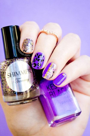 purple and gold leopard nails