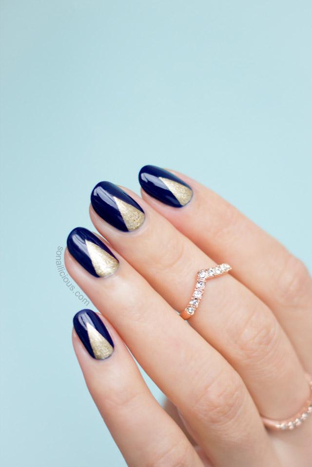 dark blue and gold nails