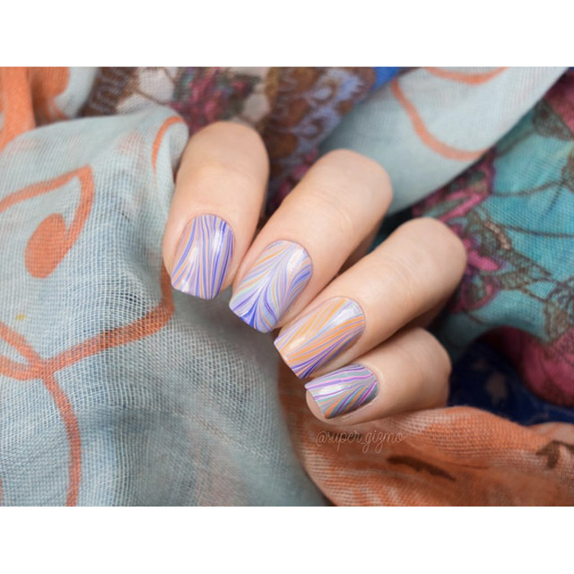 Watermarble Easter Egg nails by @super_gizmo