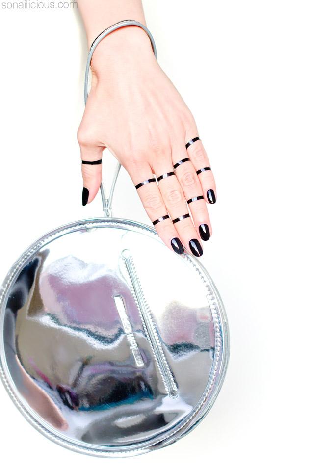 black nails, silver bag, mcqueen bag