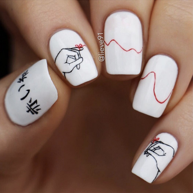 Red string nail art by @lieve91
