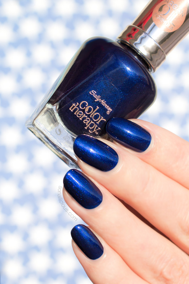 sally hansen soothing sapphire, dark blue nails
