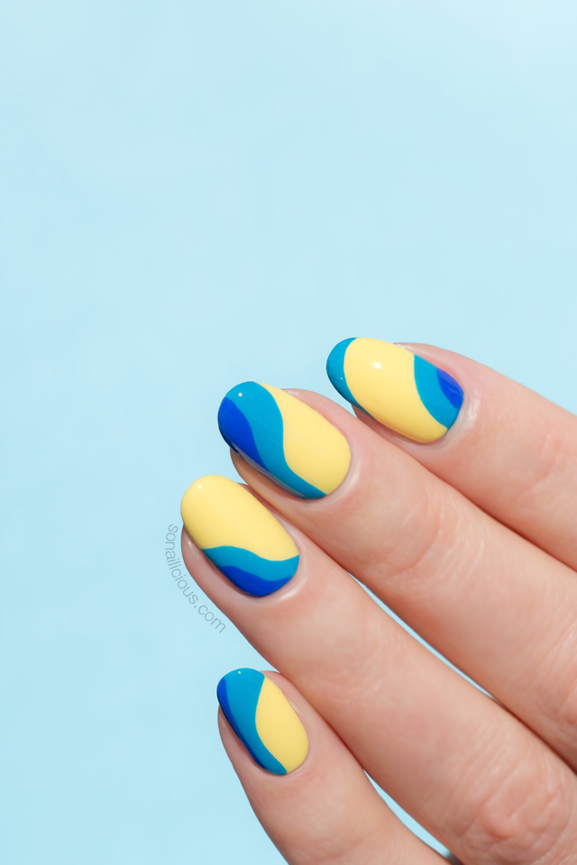 yellow nails with ocean waves