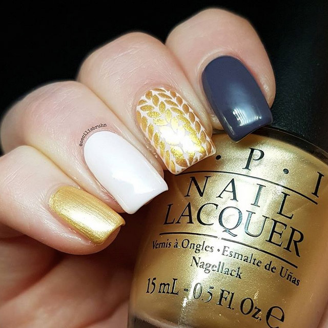 Cozy golden sweater nails by @ceciliabruhn