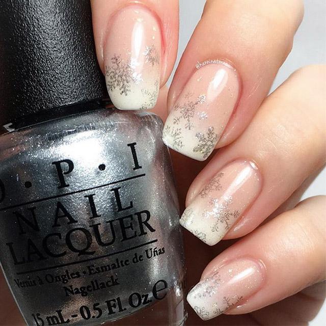 Elegant snowflake nails by @hanninator