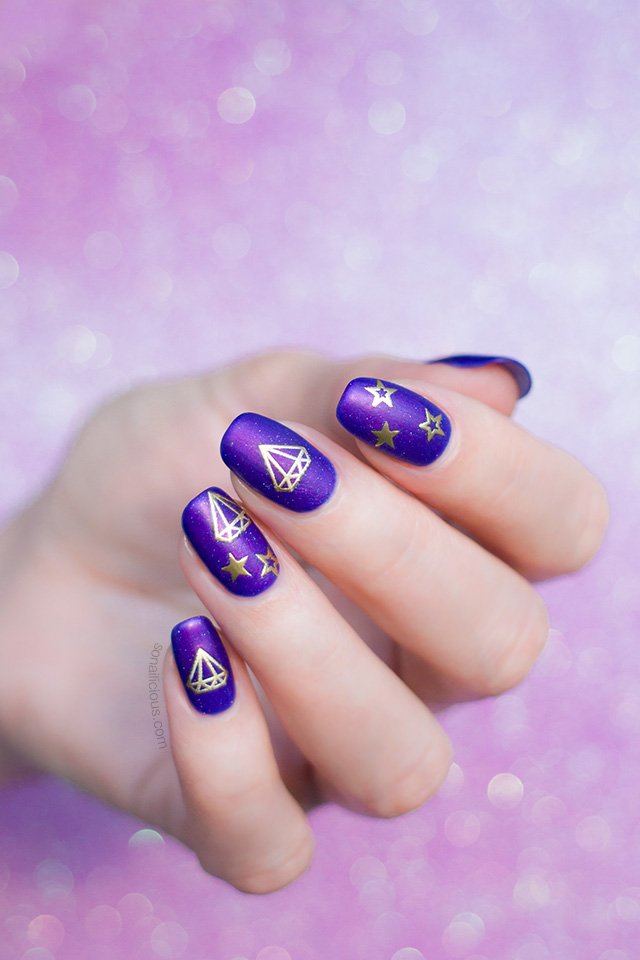 purple nails with diamonds