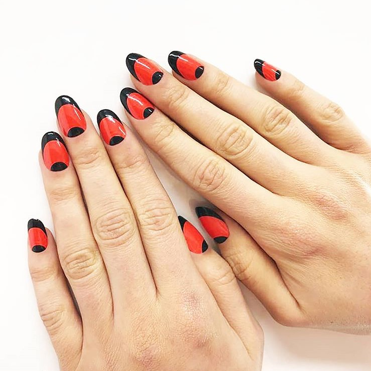 Black and red half moon manicure