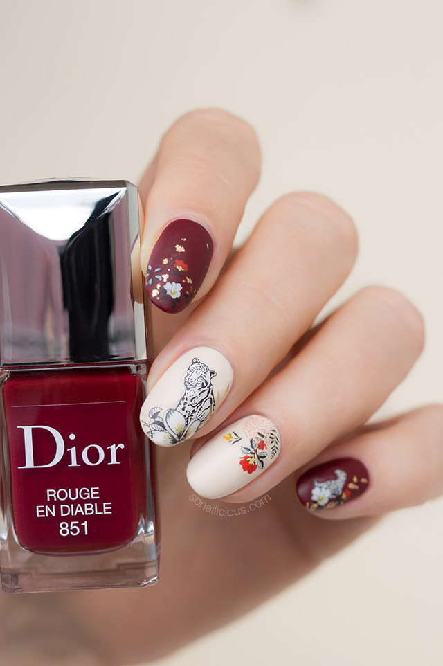 leopard nails with red dior nail polish