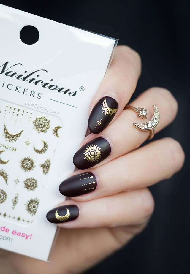 Dark red celestial nails with celestial stickers