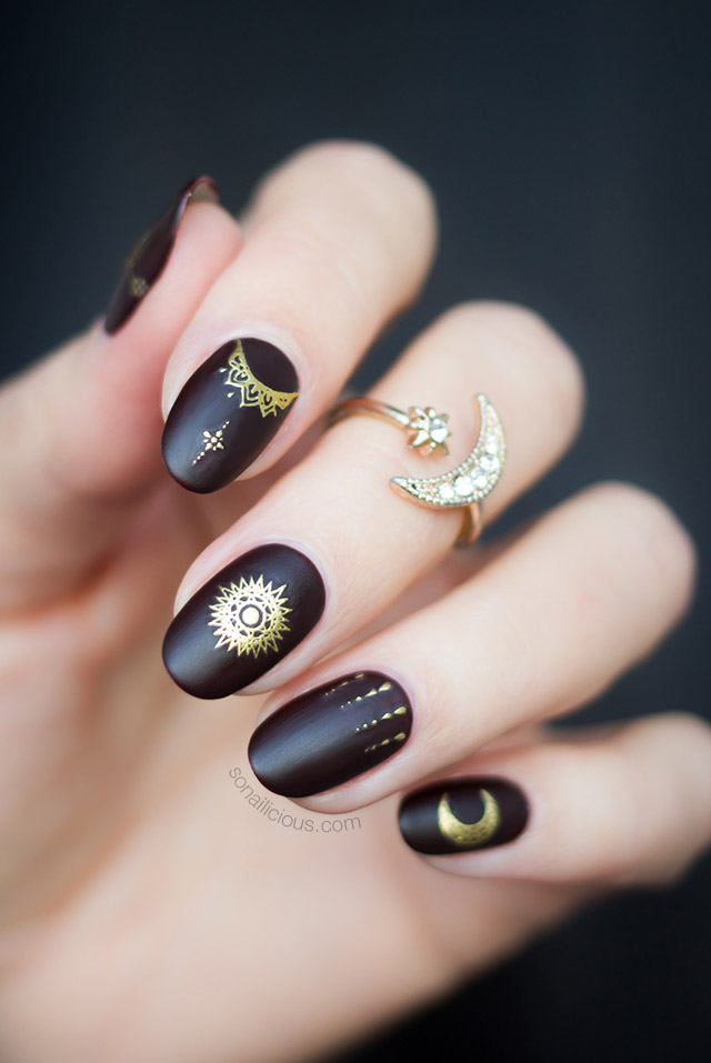 dark red and gold celestial nail art