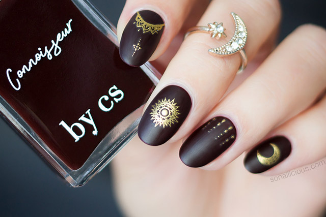 dark red and gold celestial nails