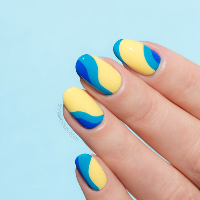abstract nails in yellow and blue
