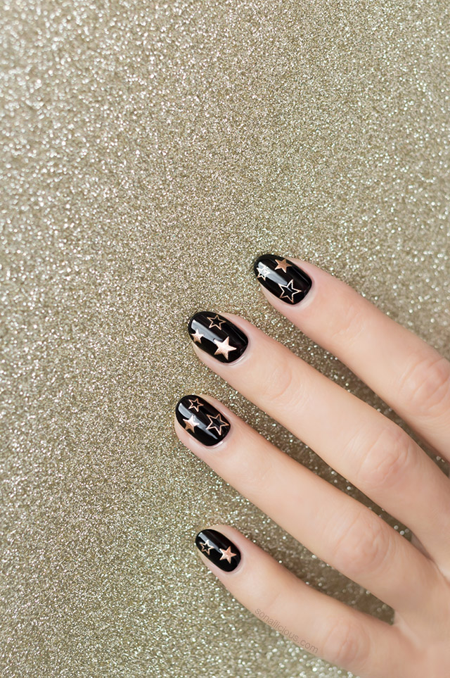 black and gold star nails with star stickers