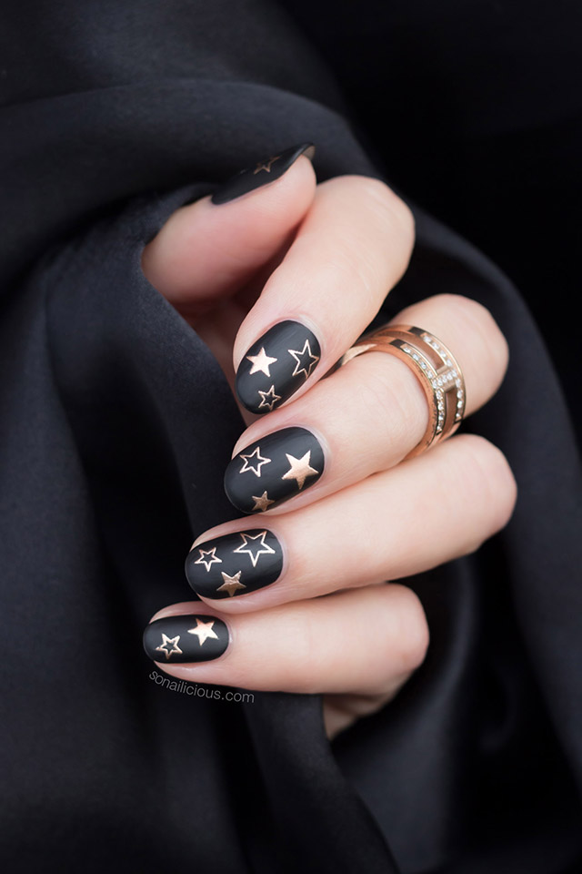 black and gold star nails