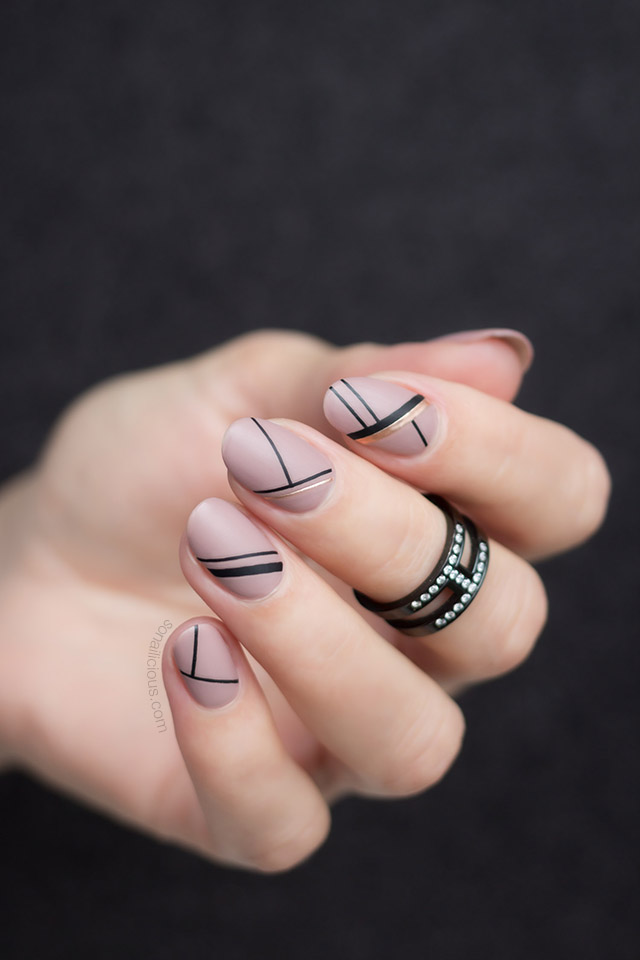 nude and black stripe nails