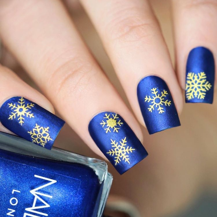 blue and gold snowflake nails