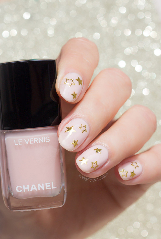 party nails with gold stars and chanel bellerina